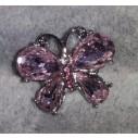 Snapknap formet som sommerfugl med lyserøde sten